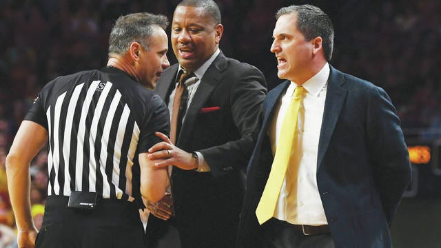 Iowa State men's basketball coach Steve Prohm argues with an official as assistant coach William Small tries to intervene when Prohm was charged with a technical foul against Baylor last season. Photo by Nirmalendu Majumdar/Ames Tribune