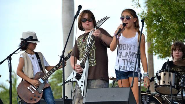 School of Rock South kids perform at a previous Palm Beach County event.