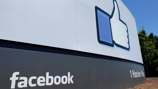 This July 16, 2013, file photo shows a sign at Facebook headquarters in Menlo Park, Calif. Social media giant Facebook is removing Trump campaign ads that contain a Nazi symbol.