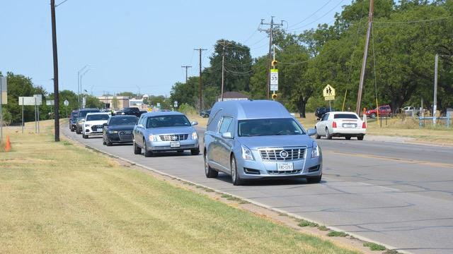 The funeral procession for Adelia Kirk proceeds along C.C. Woodson Boulevard from Victory Life Church to Greenleaf Cemetery on Saturday afternoon. The businesswoman and civic leader, a member of one of the first three African-American families who settled in Brown County, died Aug. 8, 2020, at age 70. A mortician,  Kirk and her family own several regional funeral homes, including Brownwood Funeral Home.