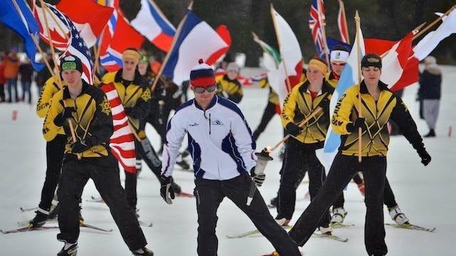 Birkie 2012 Champion Tad Elliott leads local Hayward High School Nordic Ski Team to Torch Lighting at start of 2014 Birkie Week.