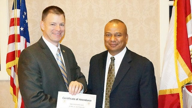 Upon completion of the Law Enforcement Division Supervisors Training Program, John A. Watterson, left, of the Dutchess County Sheriff's Office, receives certificate from New York State Sheriffs' Association President, Chemung County Sheriff Chris Moss.