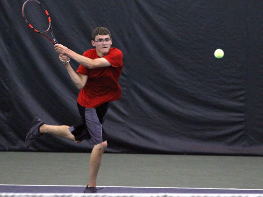 Shelby's Eric Gove fires a backhand en route to a third-place victory in Saturday's Division II sectional tennis tournament at Lakewood Racquet Club.