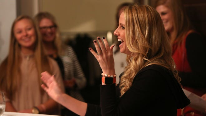 Jordan Dalton, wife of Bengal's quarterback Andy Dalton, speaks about the Andy and Jordan Dalton Foundation's Pass It On Fund during a charity bunco night on Wednesday evening.