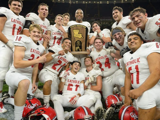 Catholic High of New Iberia, shown here displaying last year's Division III state title trophy, is hoping to repeat as state champions with a second consecutive rematch state finals with the Notre Dame Pioneers.