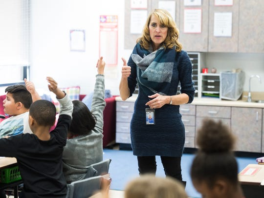 Sherrie Major instructs third grade students at Plain