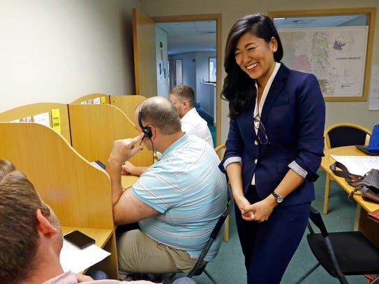 Jinyoung Lee Englund, Republican candidate for 45th district Senate seat in Washington, talks with phone bank volunteers at her campaign headquarters in Woodinville.