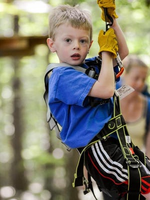 Climbing the kids' rope course at Bristol Mountain Aerial Adventures.
