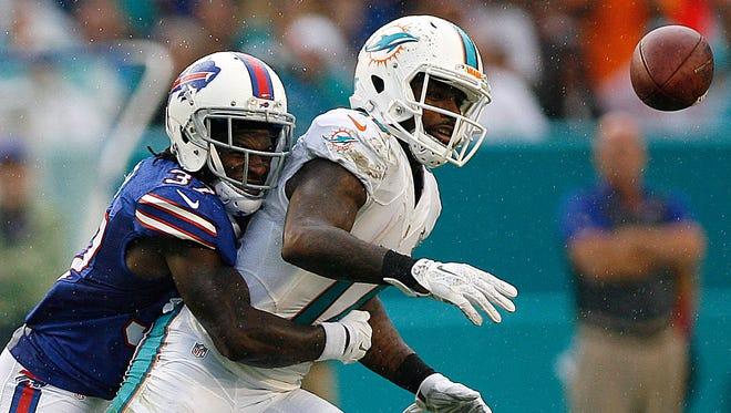 Buffalo Bills cornerback back Nickell Robey hits Miami Dolphins wide receiver Jarvis Landry  at Sun Life Stadium.