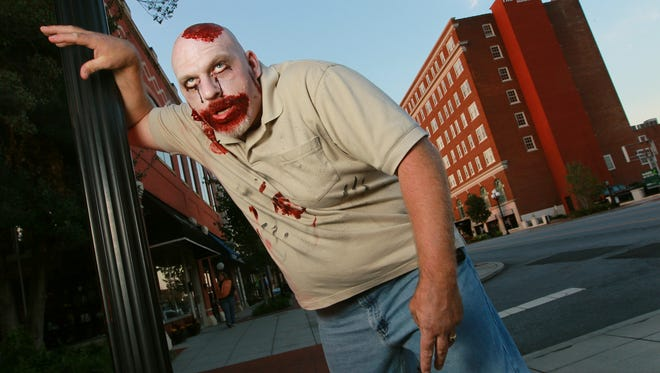 Mason Carey of Anderson, dresses the part of a zombie. Carey is president of Pints for the People and putting on the annual Zombie Pub Crawl Saturday in Anderson.