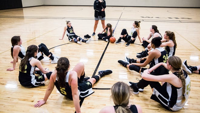 The girls basketball team prepares for state at Winchester High School during practice Tuesday, Feb. 20, 2018.