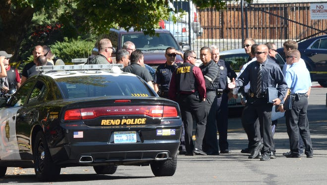 Police investigate a shooting that left one Oakland man, who was wanted for a parole violation connected to a homicide, in the hospital Wednesday morning in Reno.
