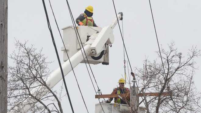 Consumers Energy crews repair lines in April 2014.
