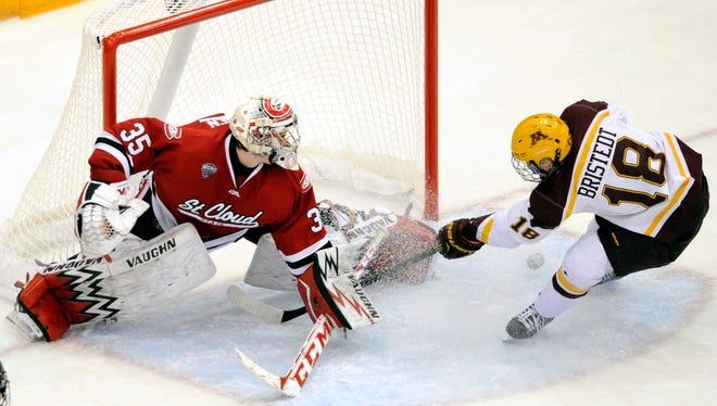 St. Cloud State goalie Charlie Lindgren (35) blocks a shot by Minnesota forward Leon Bristedt (18), of Sweden, during the third period of an NCAA college hockey game