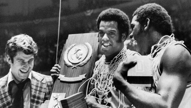 Bobby Knight, Scott May center and Quinn Buckner are all smiles as they hold the NCAA championship trophy in Philadelphia, March 30 1976.