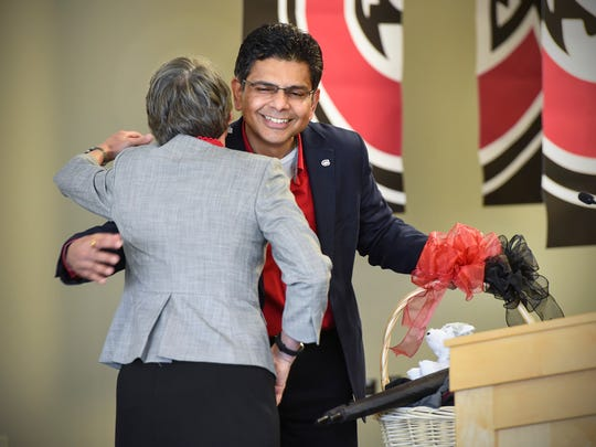 New St. Cloud State University President Robbyn Wacker gets a hug from interim President Ashish Vaidya during her introduction Thursday, May 17, at Atwood Memorial Center.