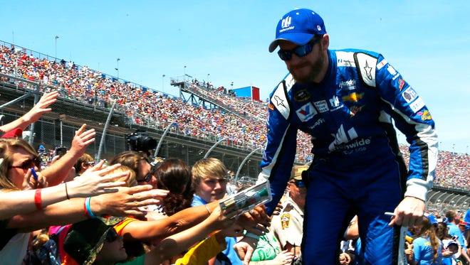 Fans at Talladega Superspeedway greet Dale Earnhardt Jr. during driver introductions. A few hours later, he was celebrating in victory lane.