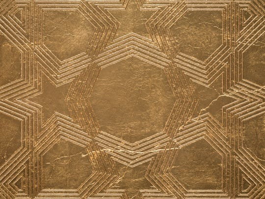 Metal is a trend even in tiles, such as this gold tile from Ann Sacks.
