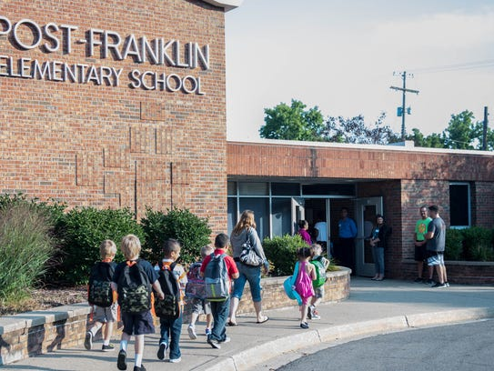 Families take their kids to their first day of school