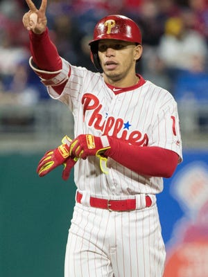 Philadelphia Phillies second baseman Cesar Hernandez (16) reacts after his double against the Pittsburgh Pirates during the eighth inning at Citizens Bank Park. Mandatory Credit: Bill Streicher-USA TODAY Sports