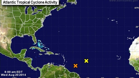This image shows the tropical wave, marked here with the orange X, that experts believe has up to a 50 percent change of becoming a tropical storm within the next week. But the trajectory of this system remains unclear as it is still too far out to determine where it is headed.