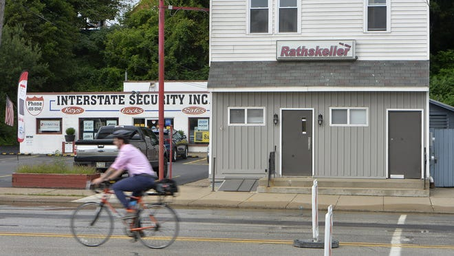 A cyclist passes by the former Rathskeller Cafe, at right, on Tuesday. The bar is located at 2603 State Street in Erie.