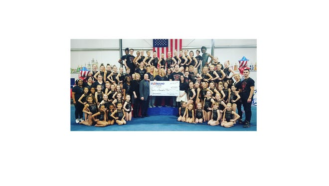 Star Bound Gymnastics Academy presented a check for $21,000 to Children's Hospital of Philadelphia for its Child Life Fund.