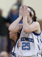 Redwood's Madison Kast reacts to the Rangers' loss against Bakersfield in a Central Section Division II girls basketball semifinal game on Wednesday, March 2, 2016.