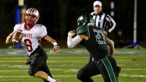 Somers quarterback Kevin Olifiers avoids a defender