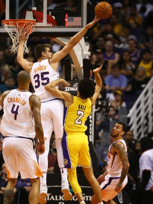 Oct 20, 2017: Phoenix Suns forward Dragan Bender (35) blocks the shot of Los Angeles Lakers guard Lonzo Ball in the second quarter at Talking Stick Resort Arena.