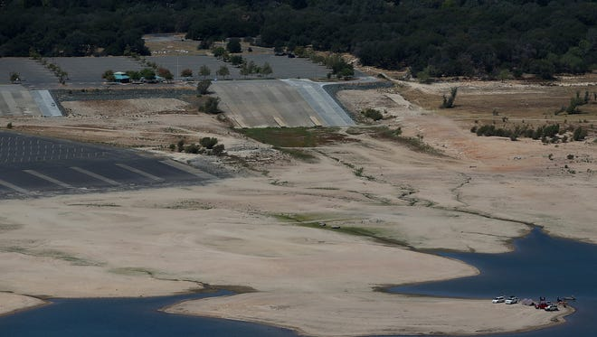 Boaters launch their boats hundreds of yards away from designated boat ramps at Folsom Lake on Aug. 19, 2014, in Folsom, Calif. As the severe drought in California continues for a third straight year, water levels in the state's lakes and reservoirs are  reaching historic lows.