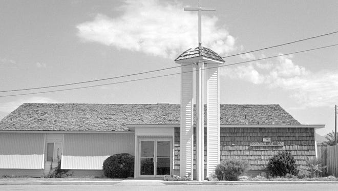 The Dixie Assembly of God Church on 750 North Street in St. George featured a large tower topped with a cross that stood in front of the building in July of 1988 when the then image was taken by a Spectrum photographer. The Dixie Assembly of God congregation moved out of the building in the spring of 2000 and changed the name of their church to the New Covenant Christian Center according to the church's website. The building that had been  constructed in 1981, has subsequently become the home of the Church of Christ and the tower has been removed as can be seen in the now image taken by Spectrum photographer Jud Burkett.