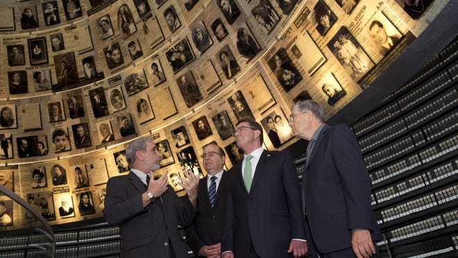 David Zilbershlag, left, guides Israeli Defense Minister Moshe Ya'alon, U.S. Defense Secretary Ashton Carter and chairman of Yad Vashem, Avner Shalev, right, through the Yad Vashem Holocaust Museum in Jerusalem on July 21, 2015. Carter said he has no expectation of persuading Israeli leaders to drop their opposition to the Iran nuclear deal, but will instead emphasize that the accord imposes no limits on what Washington can do to ensure the security of Israel and U.S. Arab allies.