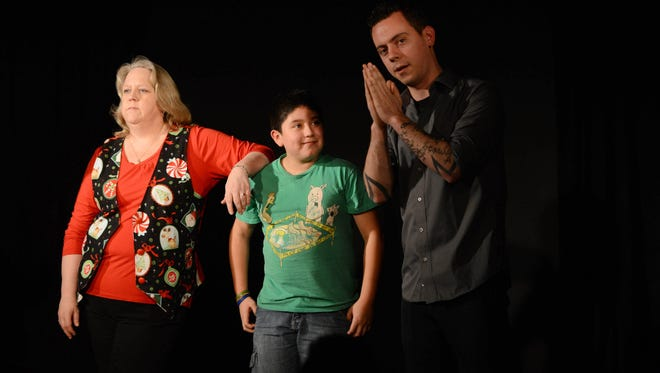Audience member Jonathan Echavarria, 12, participates in an improv session with Julie Harrison and Dave Buerge during a family-friendly show at the Capitol City Theater. The theater will be hosting a night of family-friendly stand-up comedy on Wednesday