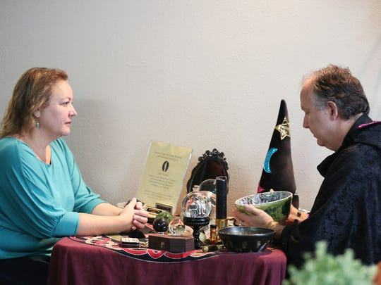 Navar D. Knight performs hydromancy, a method of divination using water, for Kim French of Salem during a Halloween/anniversary/psychic fair Sunday, Oct. 25, 2015, at Journeys...A Center for Your Soul in Salem, Ore.