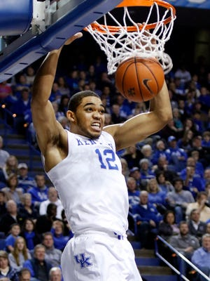 Kentucky's Karl-Anthony Towns dunks during the first half of an NCAA college basketball game Eastern Kentucky, Sunday, Dec. 7, 2014. (AP Photo/James Crisp)