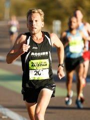 Scott Bauhs of San Luis Obispo, Calif. breaks away and and goes on to win the Rock 'n' Roll Arizona ½ Marathon in 1:02:23 on Jan. 17, 2016 in Tempe, Ariz.