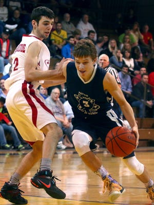 Lexington's Joey Zahn drives past Mansfield Christian's Brandon Mount in the 38th News Journal All-Star Basketball Classic. Zahn set the Classic assist record with 10, helping the North to victory.