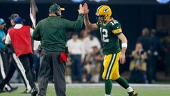 Green Bay Packers quarterback Aaron Rodgers and head
