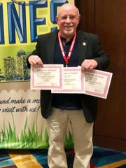 Dann Hayes with three award certificates presented to the Poweshiek County CR at the 2018 Iowa Newspaper Association convention.