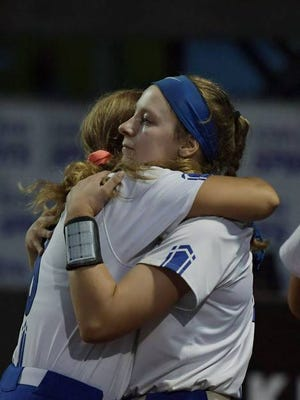 Collins-Maxwell's Mikayla Houge, right, and senior teammate Olivia Pasquariello embrace following the Spartans' 2-0 loss to Clarksville in the Class 1A state championship game on Friday in Fort Dodge. The Spartans had won the previous two 1A state titles in their first two years as a program. Photo by Nirmalendu Majumdar/Ames Tribune
