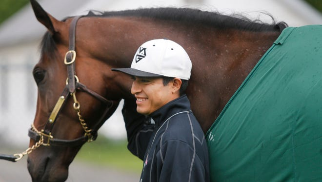 Jockey Mario Gutierrez poses with Nyquist on the backside of Churchill Downs, the morning after the duo won the Kentucky Derby. May 8, 2016.