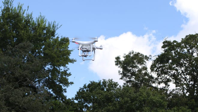 A drone belonging to the Tensas Basin Levee District flies over an area of the Ouachita River where volunteers worked to remove trash and debris that had built up during the annual Ouachita River Water Sweep on Saturday, Sept. 10, 2016.