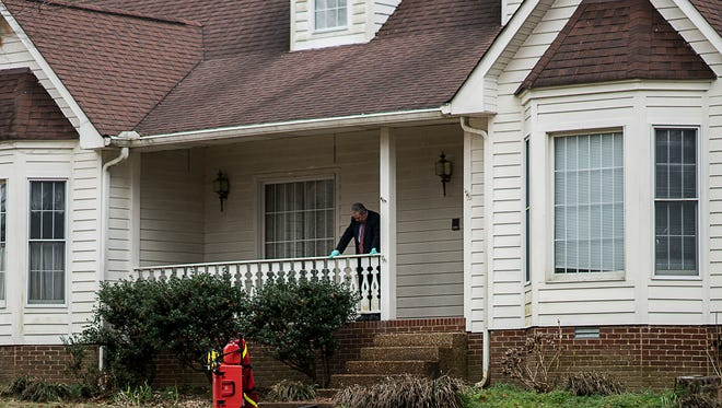 An investigator with the TBI steps out for a moment from a home on Golf Club Lane in Cheatham County, Tennessee where a possible homicide occurred on Saturday, Jan 21, 2017