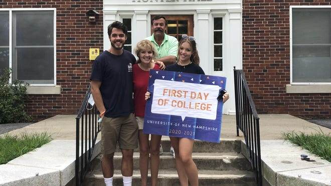 Reporter Ian Lenahan (University of New Hampshire Class of 2020), with his mother Jeannie, father Robert and sister Bridget outside Hunter Hall, where Bridget moved in as a first-year UNH student Tuesday.