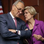 Sens. Charles Schumer, D-N.Y., and Elizabeth Warren, D-Mass., talk during a news conference on the fifth anniversary of the Dodd-Frank Wall Street Reform and Consumer Protection Act at the Capitol Visitor Center on July 21, 2015.