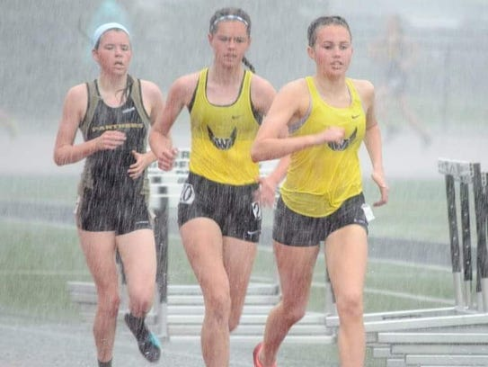 Woodmore's Olivia Thatcher and Ava Beam compete in