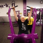 Glenn Sabatka,68, works out at Planet Fitness with trainer, Joel Rivera on Monday 2/1/2016.  Sabatka has been blind since 1978.