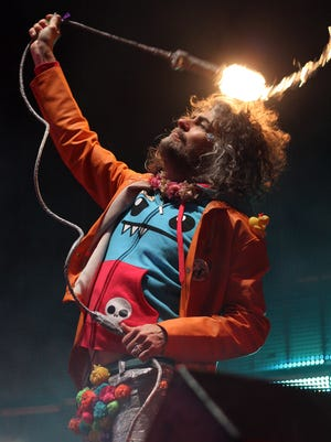 Wayne Coyne of the Flaming Lips swings a light at the Sound Harvest Music Festival at Nashville's Centennial Park on Sat. Oct. 17, 2015.