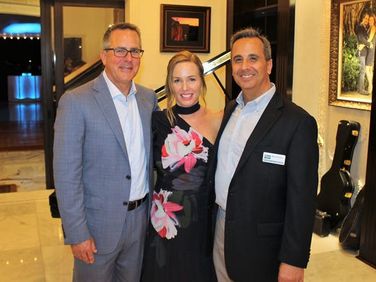 House of Hope Board President Stephen Schramm, left, with wife Colleen Schramm and House of Hope CEO Rob Ranieri.
